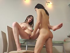 Lesbo sluts are having a naughty time on the table