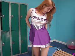 Lovely peppery haired cheerleader Scarlette Jones shows off her scrumptious ninnies and pussy