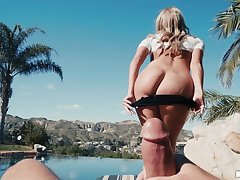 Curvy blonde sits in the matter of on your dick at the pool